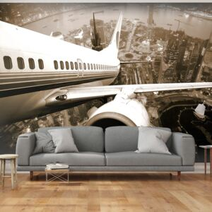Fototapeta Bimago - Airplane taking off from the city + lepidlo zdarma 200x154 cm